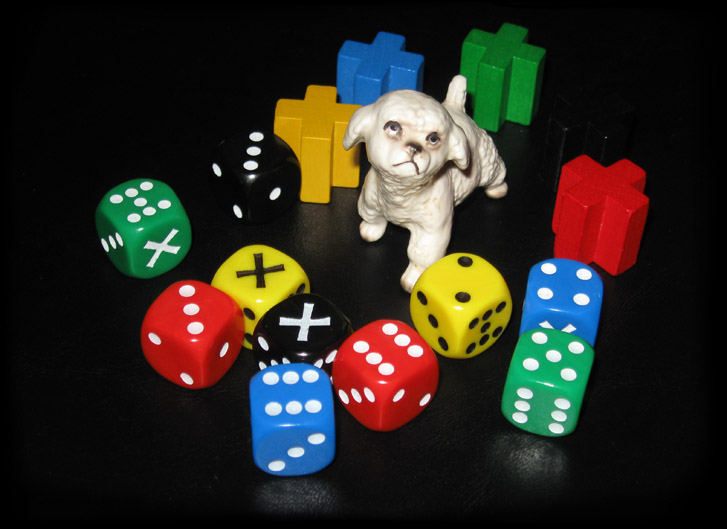tiny dog surrounded by dice